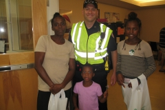 Community Police Officer poses with family