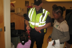 Police Officer gives out pencils to participants