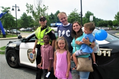 Community Police Officer shows his police car to children and parents