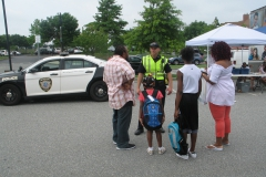 Community Police Officer talks with family