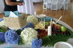 Cheese and fruit table with fresh cut flowers